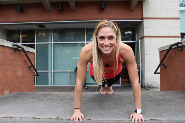 Strengthen your Core with OrthoCarolina | Woman Smiling and Doing a Plank