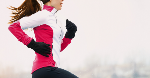 Woman running outside in cold weather