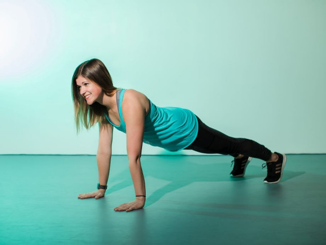 Female doing a plank getting a stronger core and better posture