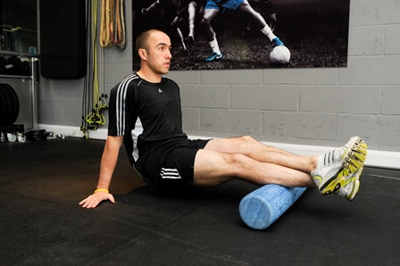 Patient using a foam roller