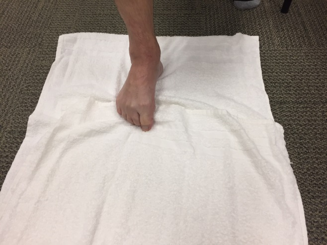 Toe stretches with towel