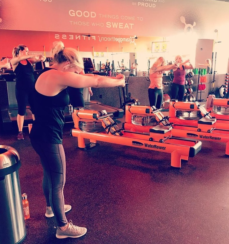 At Orange Theory Rock Hill, members finish their post-workout cool down with stretches